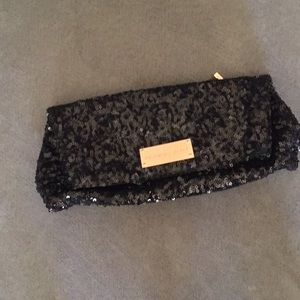 Black sequined clutch